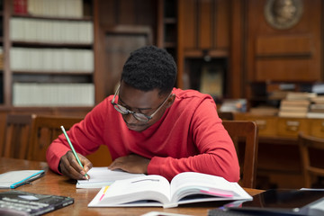 Student in library studying for exam