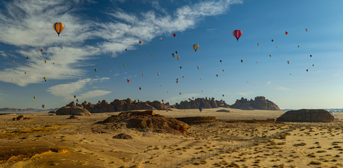 Deurstickers Ballon Winter at Tantora Hot Air Balloon Festival over Mada'in Saleh (Hegra) ancient site, Al Ula, Saudi Arabia