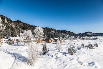 View of the winter Altai with the village of Artybash on the bank of the Biya  river. Altai Republic, Russia