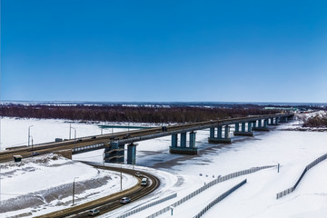 Automobile bridge over the Ob river in Barnaul in winter. Altai territory, Russia