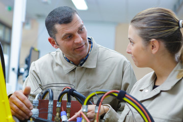 hportrait of a woman working on electronic factory
