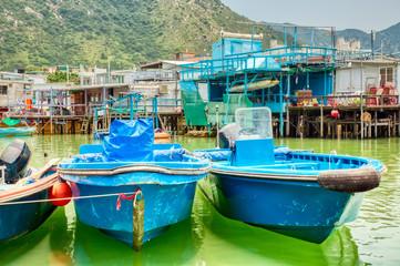 Famous tourist attraction in Hong Kong. Boats in the water in fishing village Tai O, Lantau, Hong Kong, SAR of China.