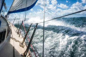 Rough seas during sailing crossing large crashing waves seasick passengers test of strength trial of character