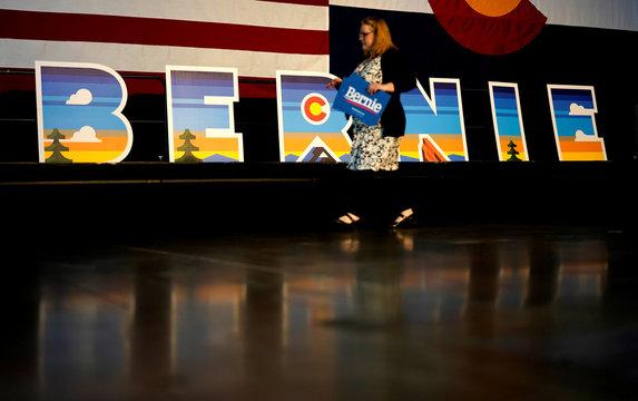 A volunteer for Democratic U.S. presidential candidate Senator Bernie Sanders walks by Bernie letters before a Sanders rally in Denver