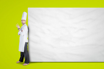 Young chef leaning on empty billboard