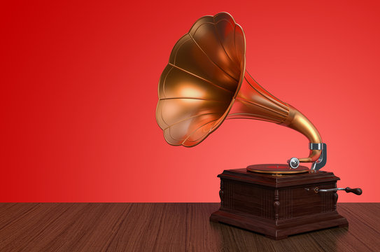 Vintage gramophone on wooden background. 3D rendering
