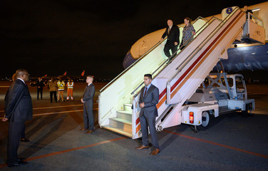 U.S. Secretary of State Mike Pompeo and his wife Susan disembark from their plane as Angolan Foreign Minister Manuel Domingos Augusto waits to greet them at 4 de Fevereiro International Airport in Luanda
