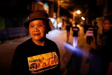 Maria Oqueria, 64, a member of a volunteer group of women patrollers, is photographed while on duty in Pateros