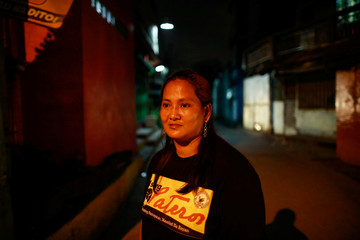 Jenny Helo, 39, the leader of a volunteer group of women patrollers, is photographed in her neighbourhood in Pateros