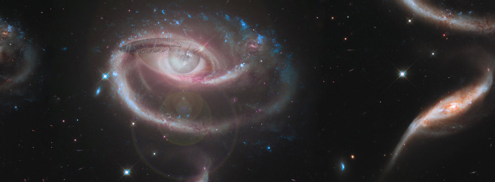 The concept of clairvoyance. A piercing look into the future against the starry sky. Paranormal abilities, clairvoyance, divination. Elements of this image are provided by NASA. Banner.