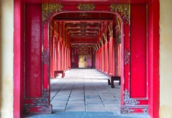 Symmetrical Corridor and Red Doors in the Forbidden Purple City, Historic Imperial Palace Hue Vietnam, United Nations World Heritage Site Wall mural