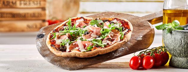 Crusty oven-fired Italian prosciutto pizza