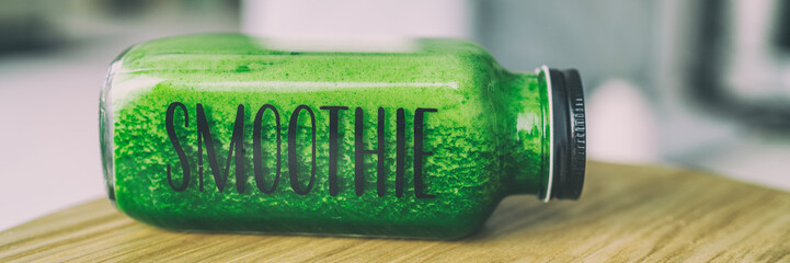 Green smoothie healthy eating drink detox celery juice diet bottle with text title SMOOTHIE for to go breakfast beverage panoramic banner.