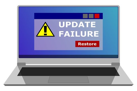 A laptop with a window showing an alert after an unsuccessful attempt to update an operating system