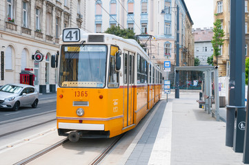 BUDAPEST, HUNGARY- JUNE 15, 2018: Antique orange tram on the street in downtown