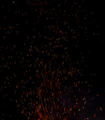 Aluminium Prints Firewood texture Fire flames on a dark background with lots of fiery sparks from a blazing fire