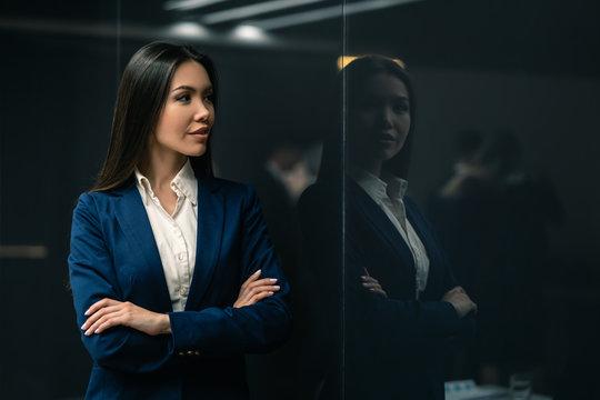 The smiling asian businesswoman standing indoor
