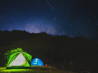 Spoed Foto op Canvas Kamperen night camping concept from tents on mountain under night sky with stars and milky way.