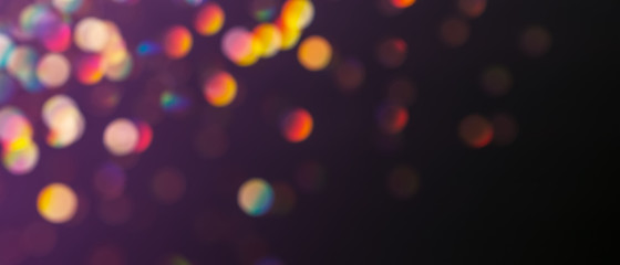 Abstract background with rainbow bokeh