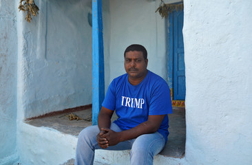 Bussa Krishna, a fan of U.S. President Donald Trump, wears a t-shirt with the word Trump as he poses for a photograph in Konney village