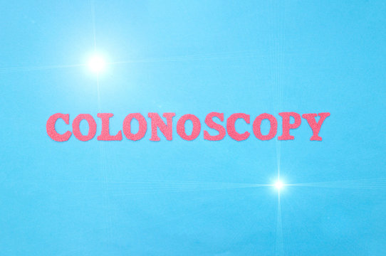 The word colonoscopy in red letters on a blue background. The concept of a medical diagnostic procedure for examining the colon and rectum in humans, intestinal cancer, gastroscopy
