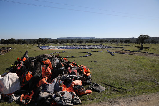 A pile of life jackets and a giant Greek flag are in the spot where the government plans to build a new migrant detention centre, in the area of Karava on the island of Lesbos