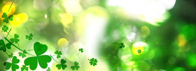 Beautiful clover leaves on blurred green background. St Patrick's day