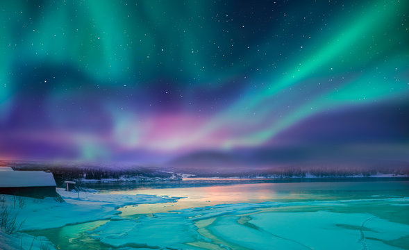 """Northern lights (Aurora borealis) in the sky over Tromso, Norway """"Elements of this image furnished by NASA"""""""