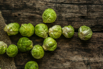 Brussels sprouts vegetables on a old wooden background.
