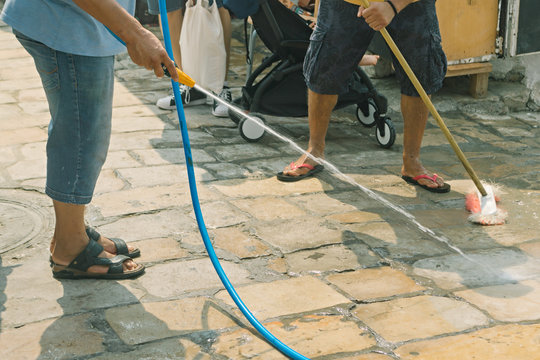 Cleaning and washing a city street