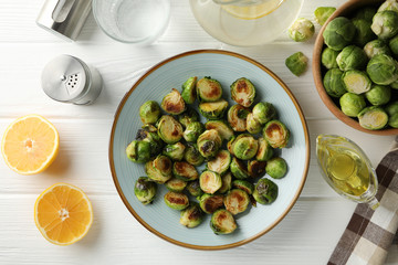 Poster Brussels Composition with plate of brussels sprout on wooden background, top view