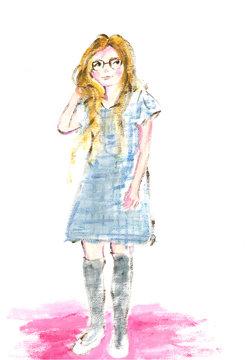 青いチェックの服を着て眼鏡をかけた女の子