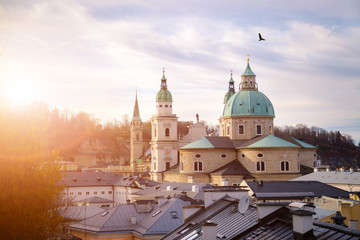 Impressive evening scenery over Salzburg: Rooftops of Cathedral, churches and houses