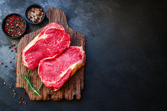 raw steak meat (beef or veal cooking) menu concept background. top view. copy spaces