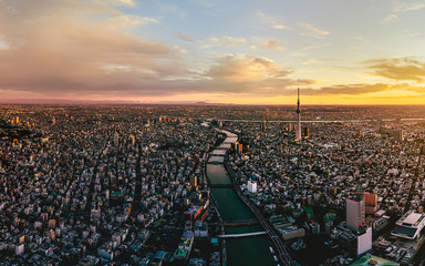 Dramatic sunrise sky of Tokyo cityscape at dawn, Japan