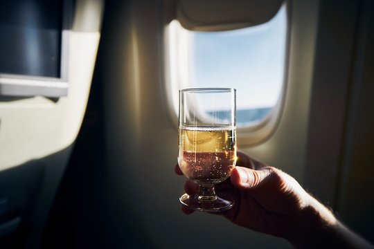 Glass of sparkling wine during flight