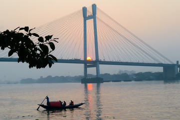 Panoramic Vidyasagar Setu or Hooghly Bridge during sunset. Famous longest cable stayed toll flyover over Ganges River connection cities Kolkata and Howrah. Calcutta West Bengal India South Asia Pac. Papier Peint