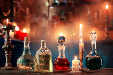 magic potions in bottles on wooden background Fototapete