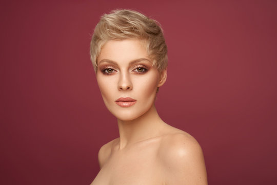 Portrait of sexy blonde woman with short hairstyle looking at camera