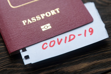 Coronavirus and travel concept. Note COVID-19 coronavirus and passport. Novel corona virus outbreak. Epidemic in Wuhan, China.