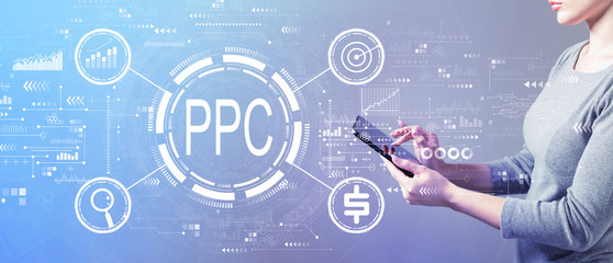 PPC - Pay per click concept with business woman using a tablet computer