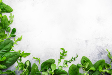 Healthy food background. Green fresh herbs mix on gray background. Vegetarian and vegan food concept. Top view copy space Fotobehang