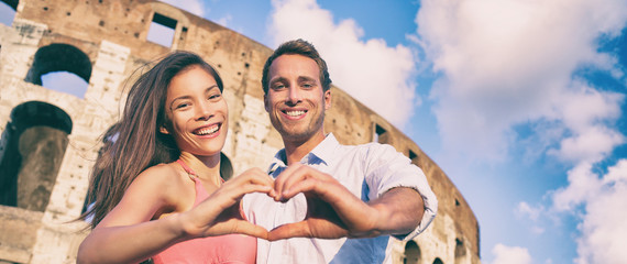 Aufkleber - Rome romantic travel destination happy couple in love making heart shape hands showing romance getaway for honeymoon holiday panoramic banner.