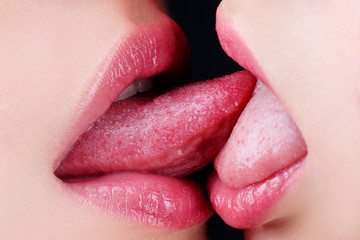 Sexy tongue in lesbian girl mouth. Homosexual concept. French Kiss. Sensual kiss in same-sex couple close up. Homosexual family.
