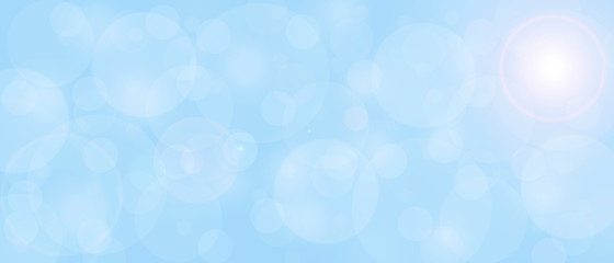 Light blue abstract background with blurry circles texture