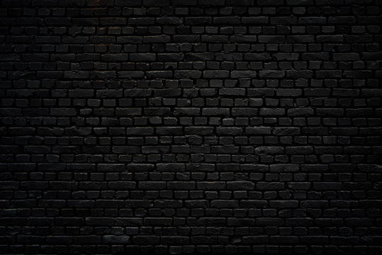 Black brick wall as background or wallpaper or texture