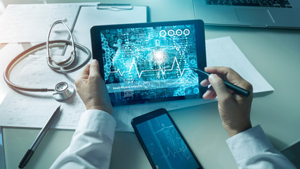 Cardiologist doctor analysis and checking data patient and  electronic medical record in tablet on digital modern virtual screen interface, Medical technology and network concept. Wall mural