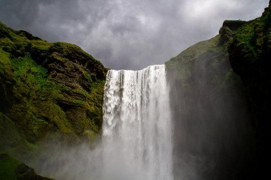 Dramatic scene of tourist popular Skógafoss waterfall, Iceland
