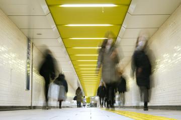 Pedestrians wearing surgical masks in subway station, Tokyo マスクをつけた人々 東京の地下鉄駅