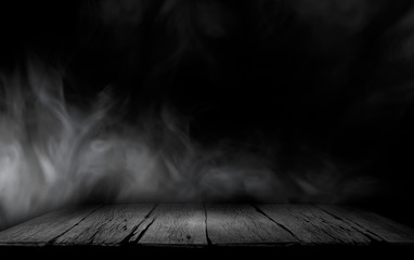 Dark empty room. Wooden table with smoke and black backgrounds.Wooden floor and wooden wall.. Wall mural